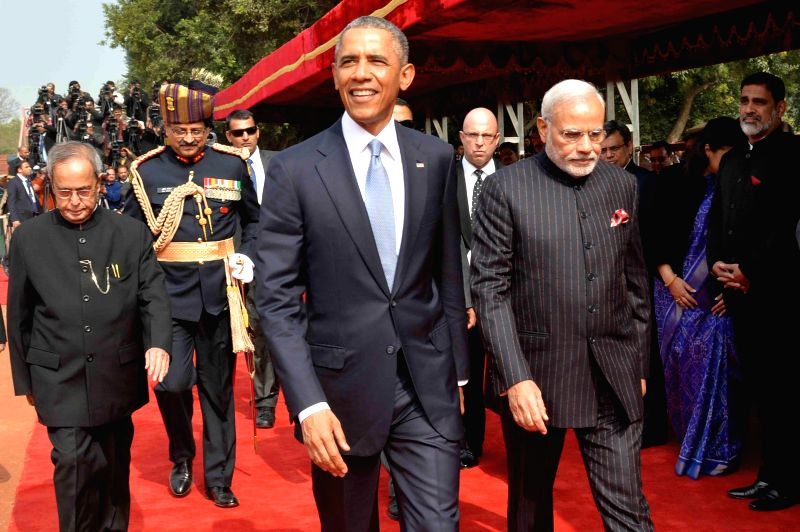 President Pranab Mukherjee and Prime Minister Narendra Modi welcome US President Barack Obama at the Rashtrapati Bhavan  in New Delhi, on Jan 25, 2015. - Narendra Modi and Pranab Mukherjee