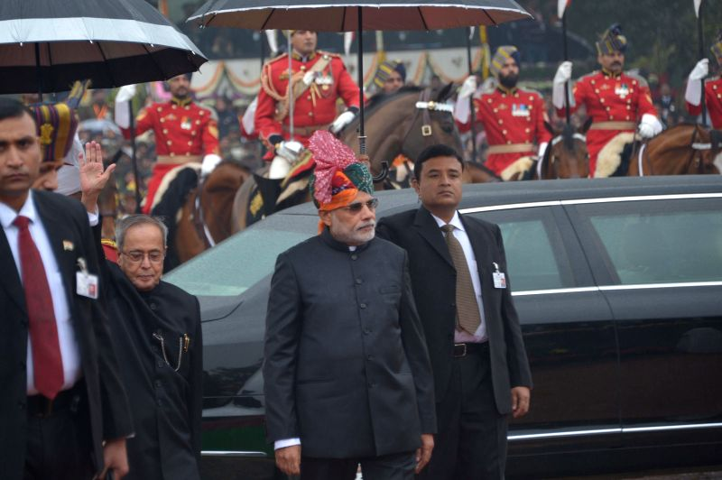 President Pranab Mukherjee and Prime Minister Narendra Modi arrive at the venue of Republic Day celebrations at Rajpath in New Delhi, on Jan 26, 2015. - Narendra Modi and Pranab Mukherjee