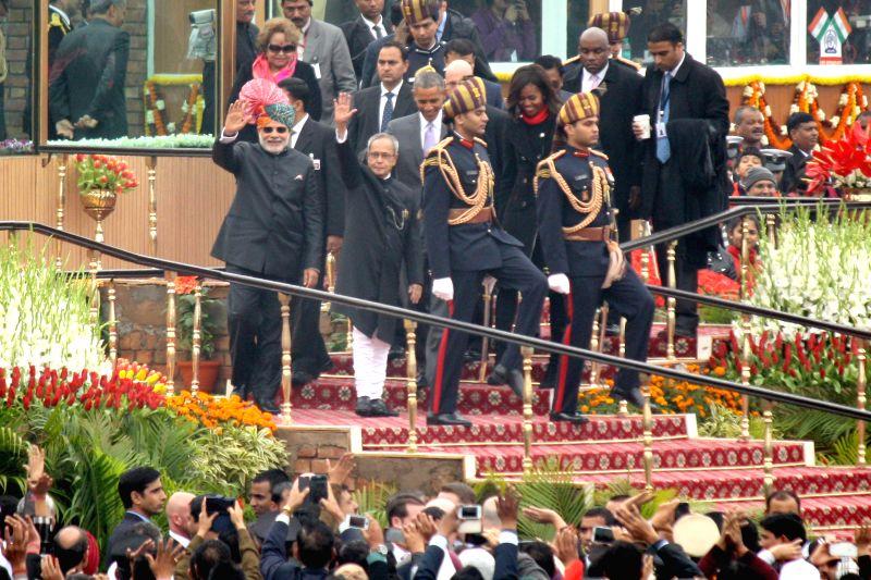 President Pranab Mukherjee and Prime Minister Narendra Modi with US President Barack Obama during  Republic Day celebrations at Rajpath in New Delhi, on Jan 26, 2015. - Narendra Modi and Pranab Mukherjee