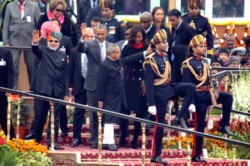 President Pranab Mukherjee and Prime Minister Narendra Modi with US President Barack Obama at the venue of Republic Day celebrations at Rajpath in New Delhi, on Jan 26, 2015. - Narendra Modi and Pranab Mukherjee