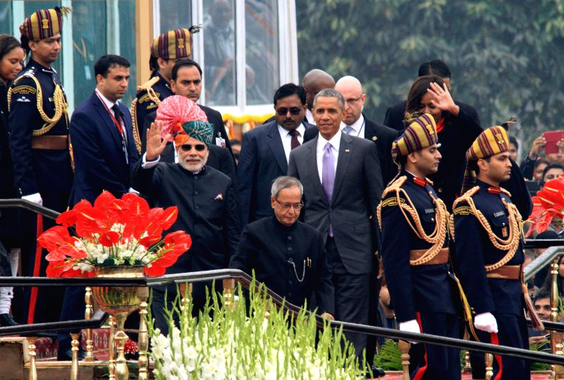 President Pranab Mukherjee and Prime Minister Narendra Modi with US President Barack Obama at the venue of Republic Day celebrations at Rajpath in New Delhi, on Jan 26, 2015. - Narendra Modi and Pranab Mukherjee