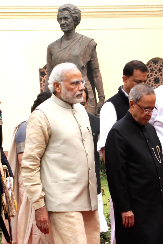 President Pranab Mukherjee and Prime Minister Narendra Modi arrive for a joint session of both the houses of the Parliament in New Delhi, on Feb 23, 2015. - Narendra Modi and Pranab Mukherjee