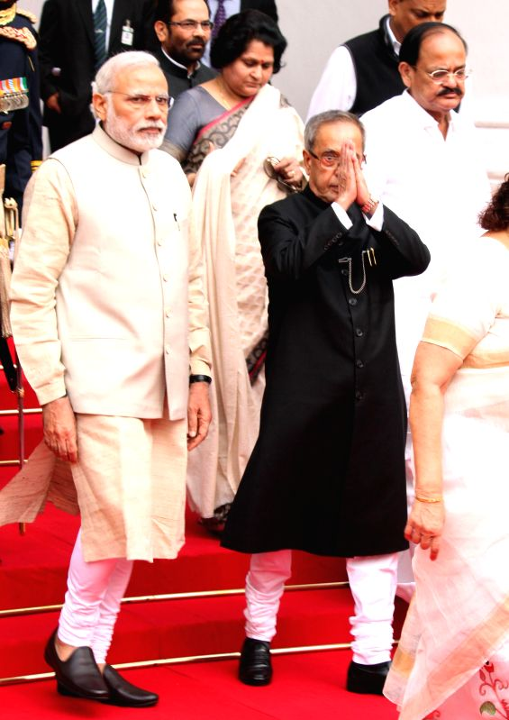 President Pranab Mukherjee and Prime Minister Narendra Modi arrive for a joint session of both the houses of the Parliament in New Delhi, on Feb 23, 2015. Also seen Union Minister for ... - Narendra Modi, Venkaiah Naidu and Pranab Mukherjee