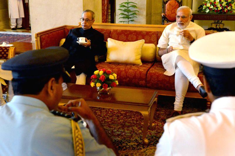 President Pranab Mukherjee and Prime Minister Narendra Modi at the Defence Investiture Ceremony–II, at Rashtrapati Bhavan, in New Delhion April 26, 2015. - Narendra Modi and Pranab Mukherjee