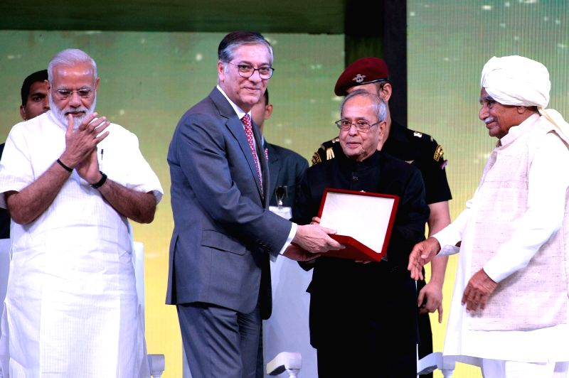 New Delhi:President Pranab Mukherjee and Prime Minister Narendra Modi during a programme organised to celebrate 90th anniversary celebration of Essel Group at Indira Gandhi Indoor Stadium in New ... - Narendra Modi and Pranab Mukherjee