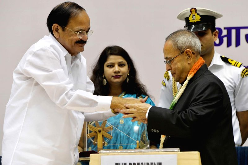 President Pranab Mukherjee and the Union Minister for Urban Development, Housing and Urban Poverty Alleviation, and Parliamentary Affairs, M. Venkaiah Naidu during inauguration of a ... - M. Venkaiah Naidu and Pranab Mukherjee