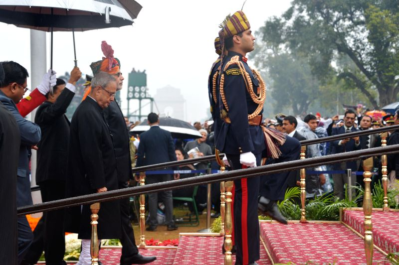 President Pranab Mukherjee arrives at the venue of Republic Day celebrations at Rajpath in New Delhi, on Jan 26, 2015. - Pranab Mukherjee