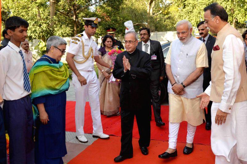 President Pranab Mukherjee arrives to present Bharat Ratna Award to former prime minister Atal Bihari Vajpayee at his residence in New Delhi on March 27, 2015. Also seen Prime Minister ... - Narendra Modi and Pranab Mukherjee