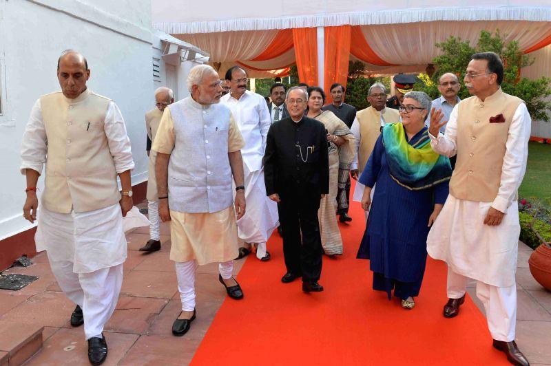 President Pranab Mukherjee arrives to present Bharat Ratna Award to former prime minister Atal Bihari Vajpayee at his residence in New Delhi on March 27, 2015. Also seen Prime Minister ... - Narendra Modi, M. Venkaiah Naidu, Pranab Mukherjee and Rajnath Singh