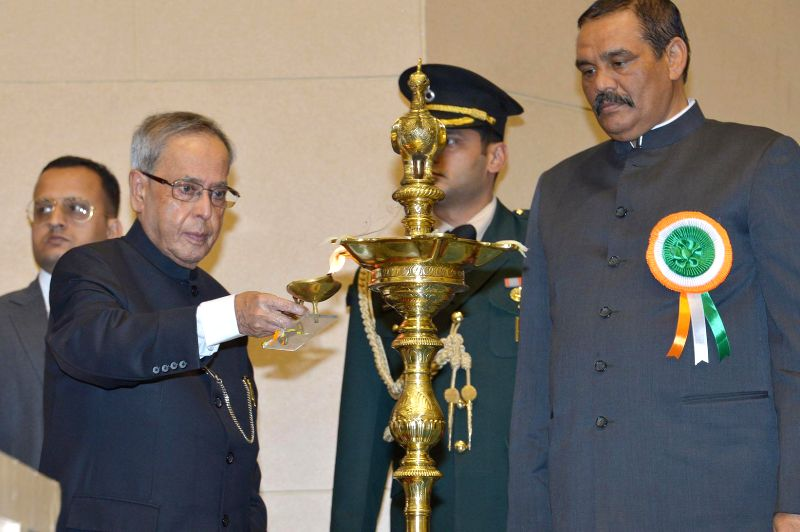 President Pranab Mukherjee at the presentation ceremony of the National Awards for the Empowerment of Persons with Disabilities 2014, in New Delhi on Dec 3, 2014. Also seen the Minister of