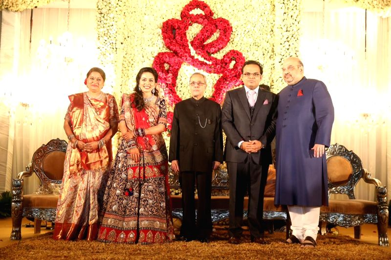 President Pranab Mukherjee attends BJP President, Amit Shah`s son Jay and daughter-in-law Rishita wedding receptions in New Delhi, on Feb 15, 2015.
