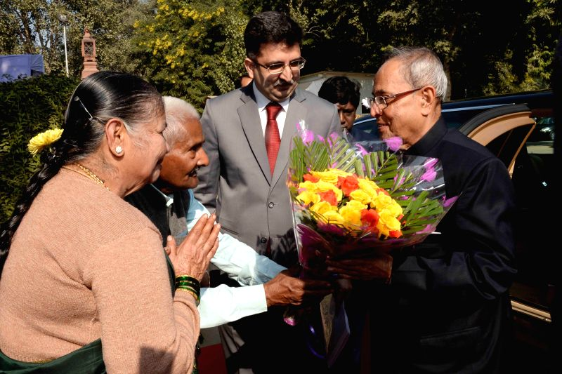 President Pranab Mukherjee being greeted by elderly people on his birthday at Rashtrapati Bhavan in New Delhi, on Dec 11, 2014. - Pranab Mukherjee