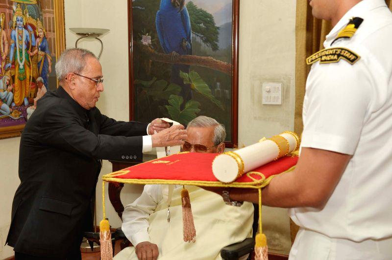 President Pranab Mukherjee confers Bharat Ratna to former prime minister Atal Bihari Vajpayee at his residence in New Delhi on March 27, 2015. - Pranab Mukherjee
