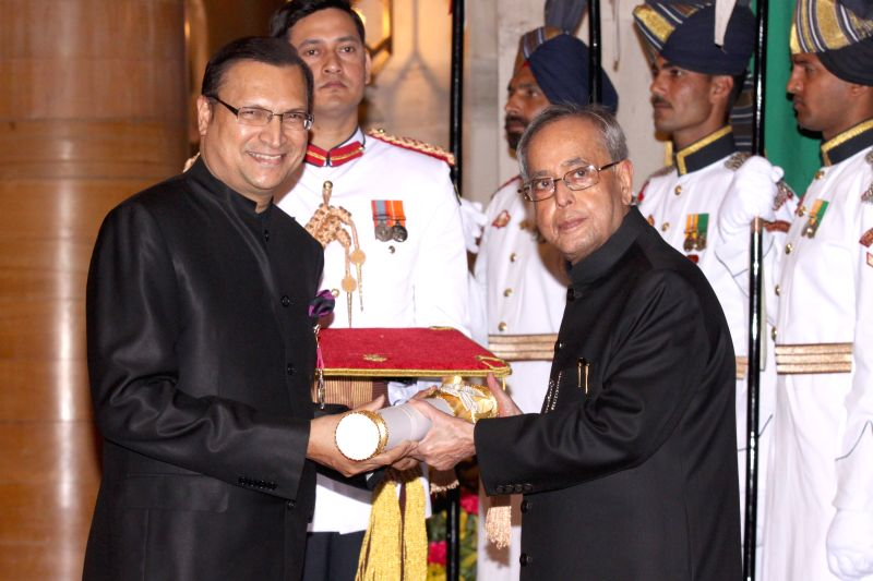 President Pranab Mukherjee confers the Padma Bhushan Award to the chairman and editor-in chief of India TV Rajat Sharma at a Civil Investiture Ceremony, at Rashtrapati Bhavan, in New Delhi ... - Pranab Mukherjee