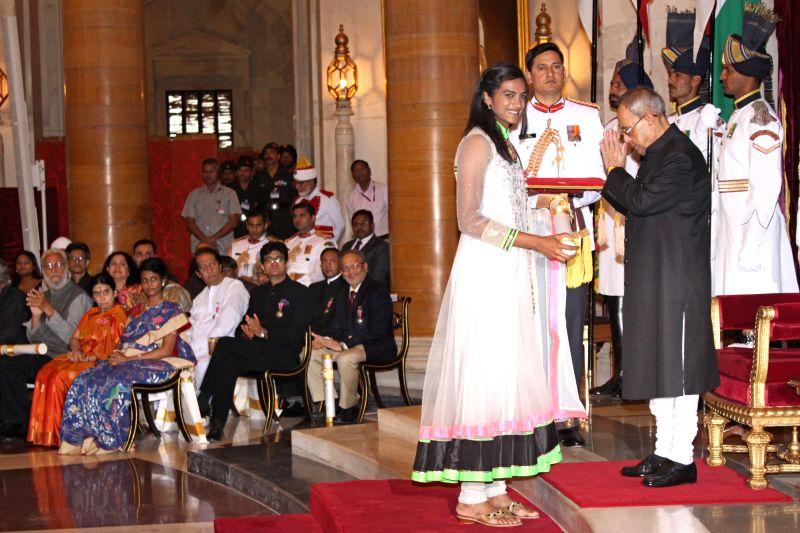 President Pranab Mukherjee confers the Padma Shri Award to Indian badminton player P V Sindhu, at a Civil Investiture Ceremony, at Rashtrapati Bhavan, in New Delhi on March 30, 2015. - Pranab Mukherjee