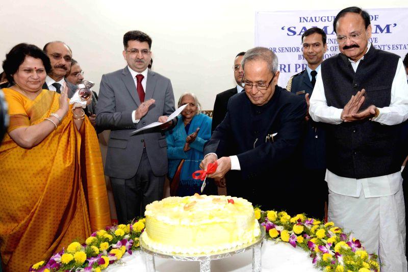 President Pranab Mukherjee cuts a cake on his birthday at Rashtrapati Bhavan in New Delhi, on Dec 11, 2014. - Pranab Mukherjee