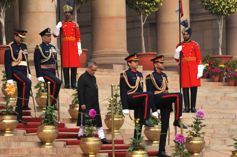 President Pranab Mukherjee departs for the Parliament House from Rashtrapati Bhavan where he is scheduled to address the members of both the houses, in New Delhi, on Feb 23, 2015. - Pranab Mukherjee