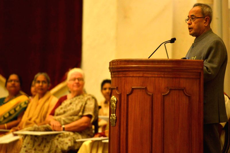 President Pranab Mukherjee during a programme organised to present Stree Shakti Puraskar 2014 on the occasion of International Women's Day, at Rashtrapati Bhavan, in New Delhi on March ... - Pranab Mukherjee