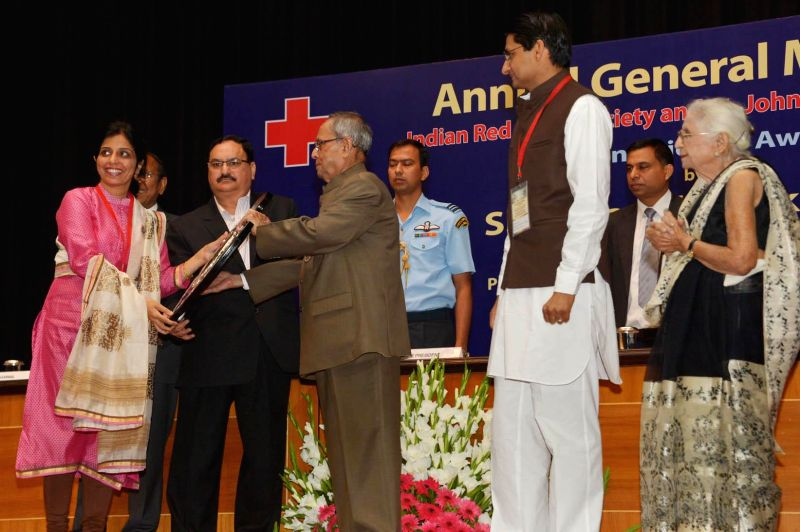 President Pranab Mukherjee felicitates volunteers during the Annual General Meeting of Indian Red Cross Society (IRCS) and St. John Ambulance (India) at Rashtrapati Bhavan in New Delhi, on - Pranab Mukherjee