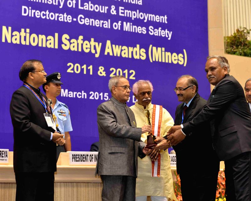 President Pranab Mukherjee lights at the presentation ceremony of the National Safety Awards (Mines) for the years 2011 and 2012, in New Delhi on March 20, 2015. Also seen the Union ... - Pranab Mukherjee
