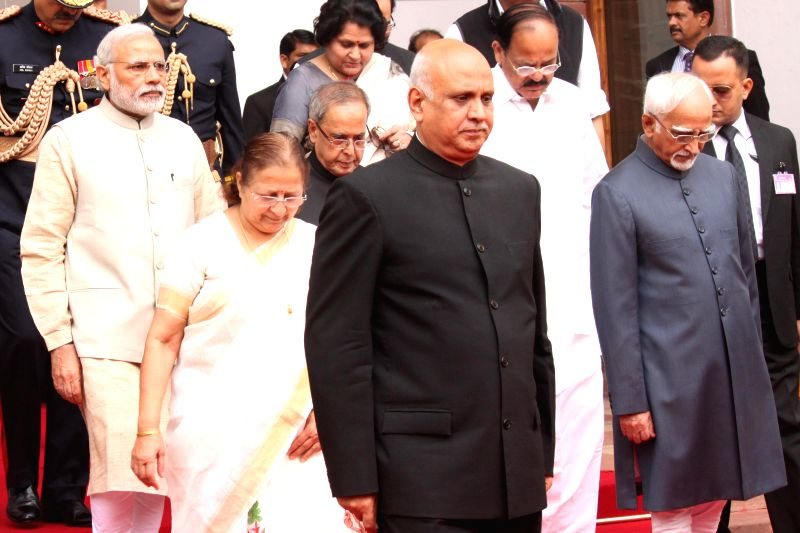President Pranab Mukherjee, Lok Sabha Speaker Sumitra Mahajan and Prime Minister Narendra Modi arrive for a joint session of both the houses of the Parliament in New Delhi, on Feb 23, ... - Sumitra Mahajan, Narendra Modi, Venkaiah Naidu and Pranab Mukherjee