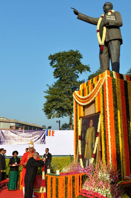 President Pranab Mukherjee, offering tributes at the statue of Baba Saheb Dr. BR Ambedkar on the occasion of his 'Mahaparinirvan Diwas' at Parliament House Lawns on Dec. 6, 2014.