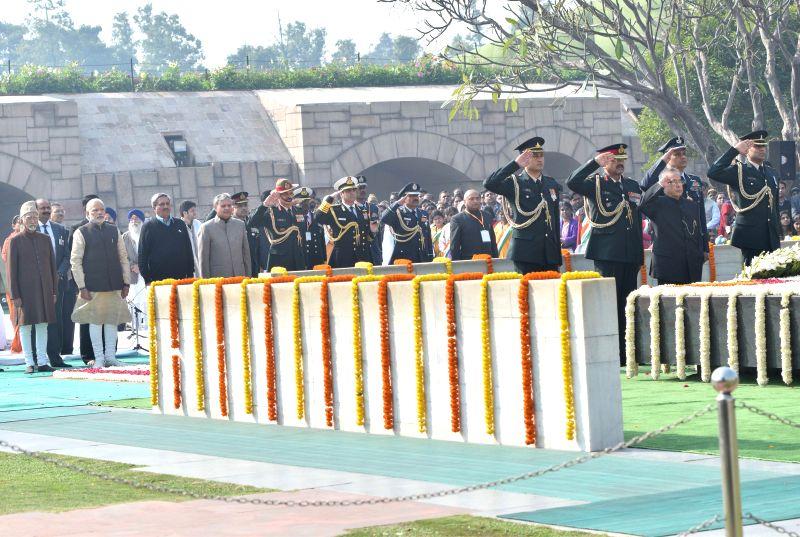 President Pranab Mukherjee paying homage at the Samadhi of Mahatma Gandhi on the occasion of Martyr's Day, at Rajghat, in Delhi on Jan. 30, 2015. The Vice President, Mohd. Hamid Ansari, ... - Narendra Modi, Pranab Mukherjee, Rao Inderjit Singh and Dalbir Singh