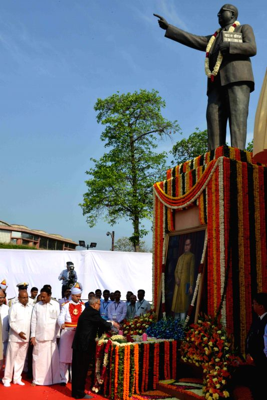 President Pranab Mukherjee pays homage to the statue of Babasaheb Dr. B.R. Ambedkar on the occasion of his 124th birth anniversary, at Parliament House, in New Delhi on April 14, 2015. - Pranab Mukherjee