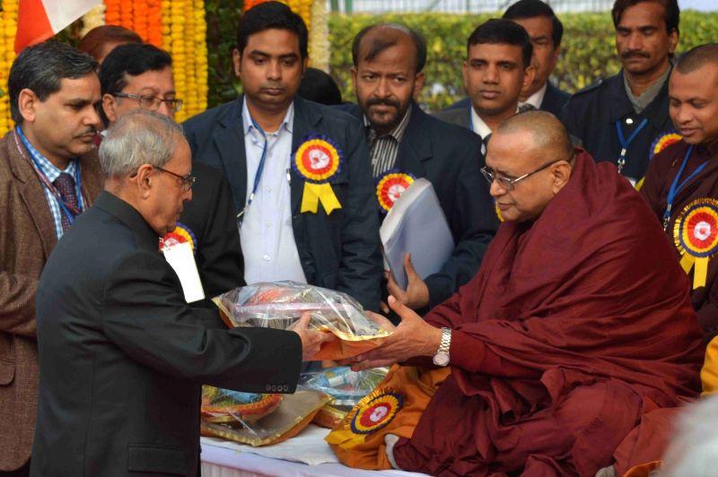 New Delhi:President Pranab Mukherjee  pays homage to Bodhisatva Babasaheb Dr. BR Ambedkar on his 60th Mahaparinirvan Diwas, at Parliament House Lawns in New Delhi on Dec 6, 2015. - Pranab Mukherjee