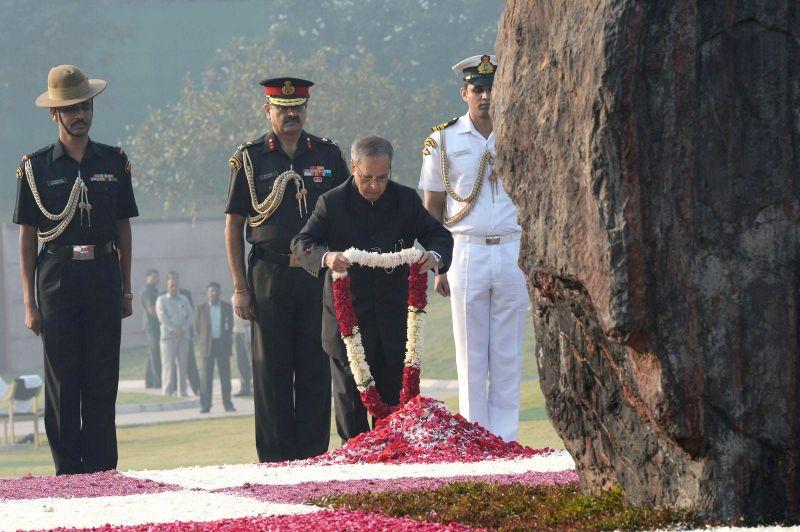 President Pranab Mukherjee pays tribute to former prime minister of India Indira Gandhi on her birth anniversary at Shakti Sthal - her memorial -  in New Delhi, on Nov 19, 2014. - Pranab Mukherjee