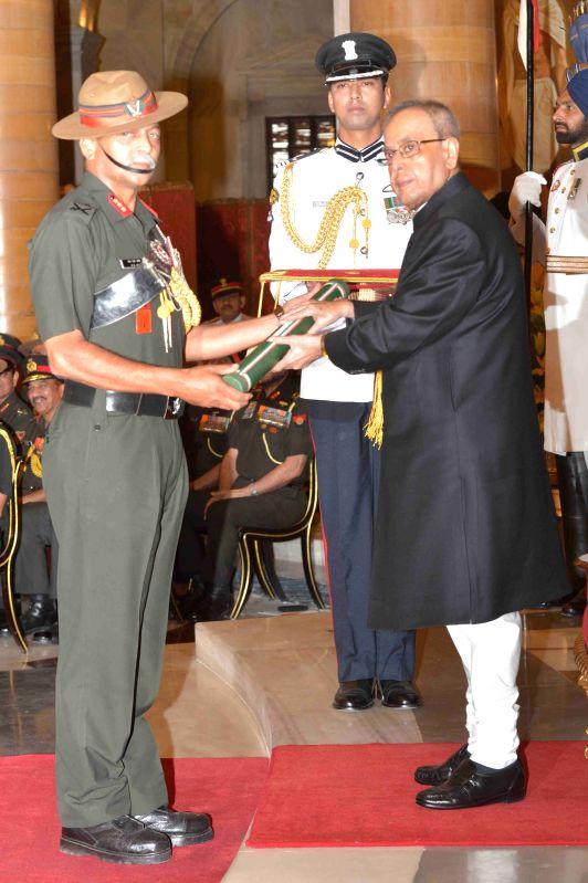 President Pranab Mukherjee presenting the Ati Vishisht Seva Medal at the Defence Investiture Ceremony–II, at Rashtrapati Bhavan, in New Delhion April 26, 2015. - Pranab Mukherjee