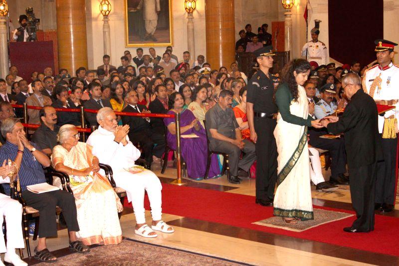 President Pranab Mukherjee presents Shaurya Chakra to Major Abhijai (Posthumous) during the Defence Investiture Presentation Ceremony at Rashtrapati Bhavan in New Delhi, on March 21, 2015. ... - Narendra Modi and Pranab Mukherjee