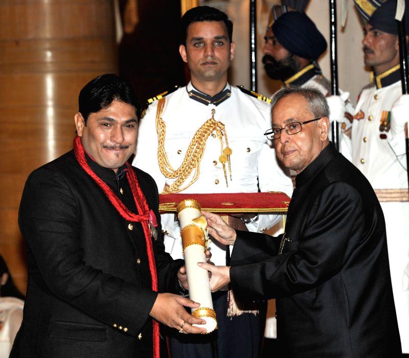 President Pranab Mukherjee presents Padma Shri Award to Dr. Sunil Jogi, at a Civil Investiture Ceremony, at Rashtrapati Bhavan, in New Delhi on April 8, 2015. - Pranab Mukherjee