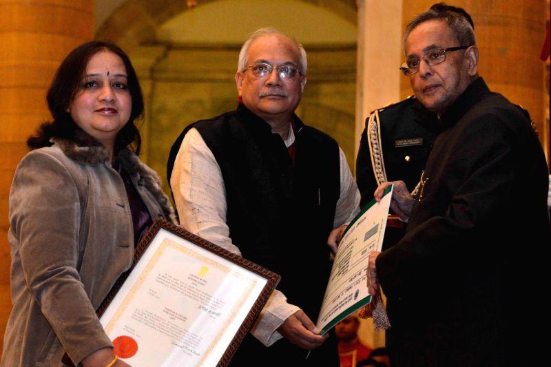 President Pranab Mukherjee presents the `First Visitor`s Award - 2015` at Rashtrapati Bhavan in New Delhi on Feb. 4, 2015. - Pranab Mukherjee