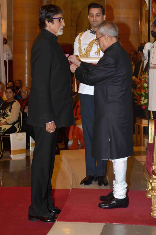 President Pranab Mukherjee presents the Padma Vibhushan Award to veteran actor Amitabh Bachchan during a Civil Investiture Ceremony organised at the Rashtrapati Bhavan in New Delhi on ... - Pranab Mukherjee