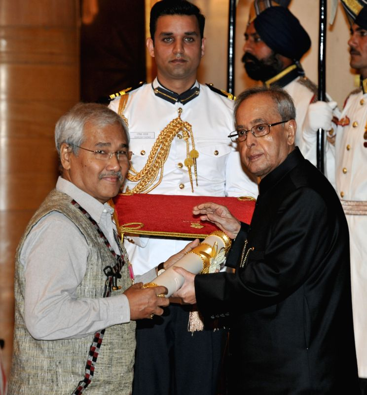 President Pranab Mukherjee presents the Padma Bhushan Award to filmmaker Jahnu Barua during a Civil Investiture Ceremony organised at the Rashtrapati Bhavan in New Delhi on April 8, 2015. - Pranab Mukherjee