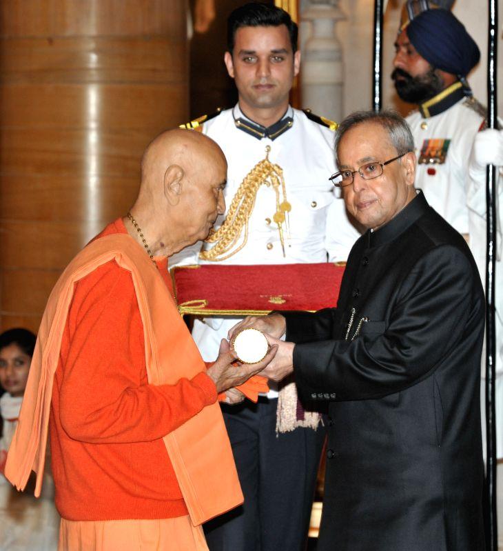 President Pranab Mukherjee presents the Padma Bhushan Award to Swami Satyamitranand Giri during a Civil Investiture Ceremony organised at the Rashtrapati Bhavan in New Delhi on April 8, ... - Pranab Mukherjee