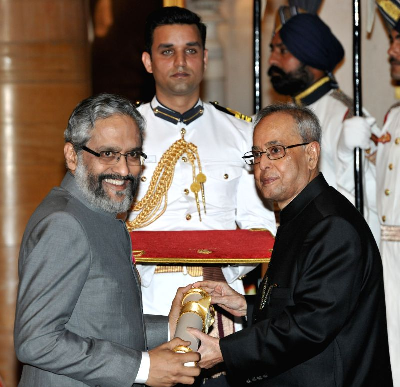 President Pranab Mukherjee presents the Padma Bhushan Award to Dr. Ambrish Mithal during a Civil Investiture Ceremony organised at the Rashtrapati Bhavan in New Delhi on April 8, 2015. - Pranab Mukherjee