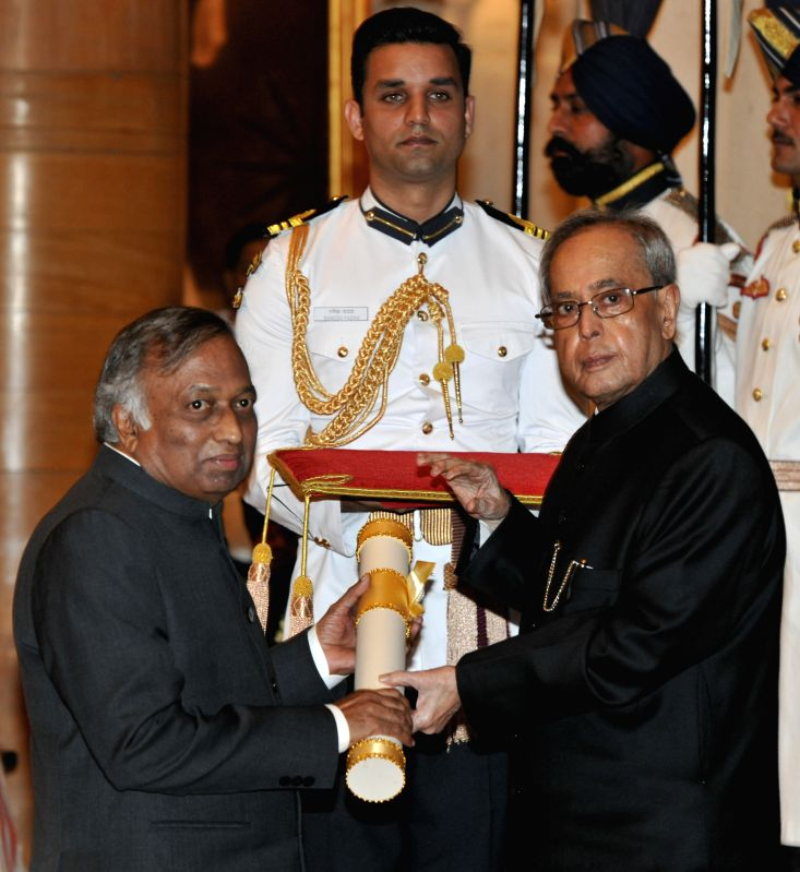 President Pranab Mukherjee presents the Padma Bhushan Award to the Chairman, Board of Governors, IIT Delhi Dr. Vijay Bhatkar during a Civil Investiture Ceremony organised at the ... - Pranab Mukherjee