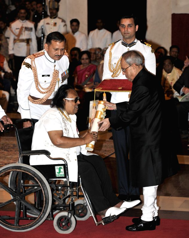 President Pranab Mukherjee presents the Padma Shri Award to Ravindra Jain, at a Civil Investiture Ceremony, at Rashtrapati Bhavan, in New Delhi on April 8, 2015. - Pranab Mukherjee