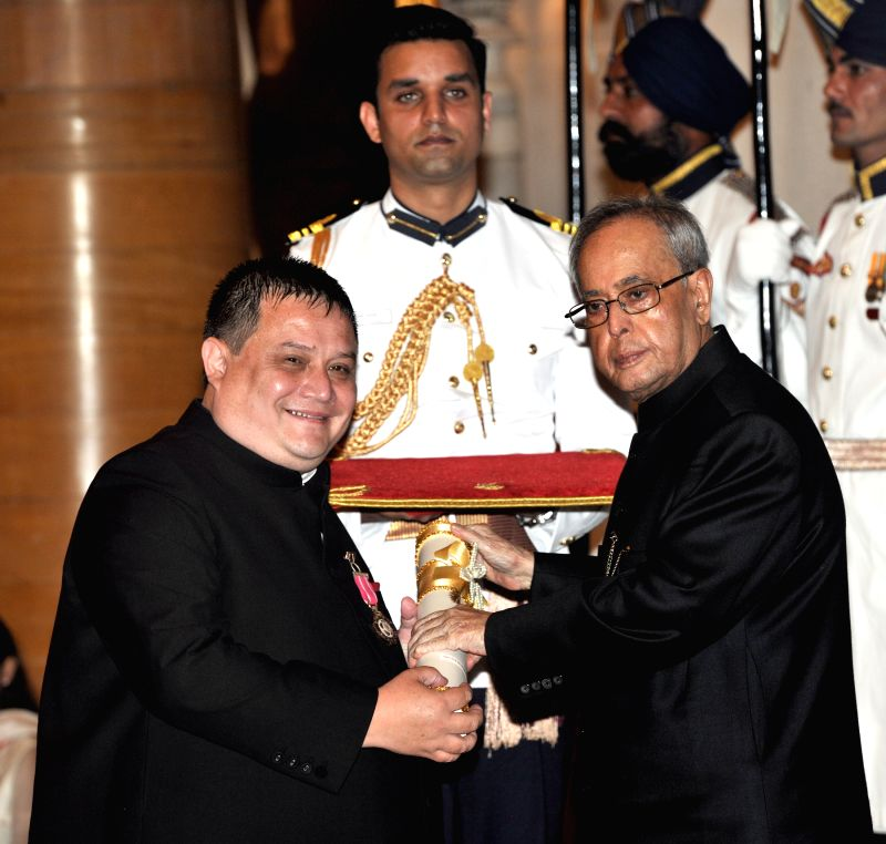 President Pranab Mukherjee presents the Padma Shri Award to Neil Herbert Nongkynrih, at a Civil Investiture Ceremony, at Rashtrapati Bhavan, in New Delhi on April 8, 2015. - Pranab Mukherjee