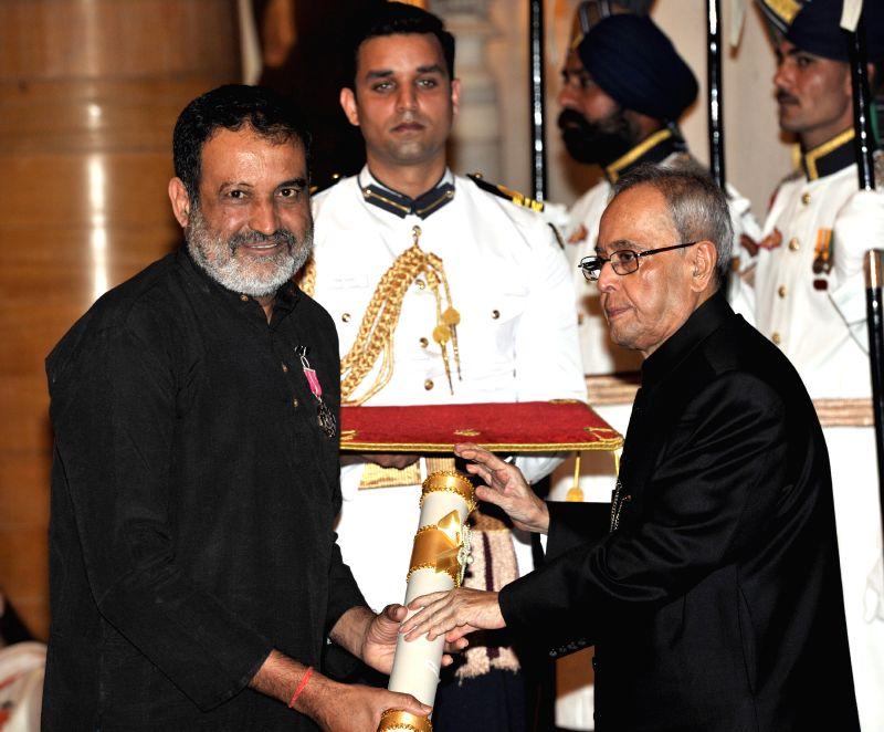 President Pranab Mukherjee presents the Padma Shri Award to T.V. Mohandas Pai, at a Civil Investiture Ceremony, at Rashtrapati Bhavan, in New Delhi on April 8, 2015. - Pranab Mukherjee