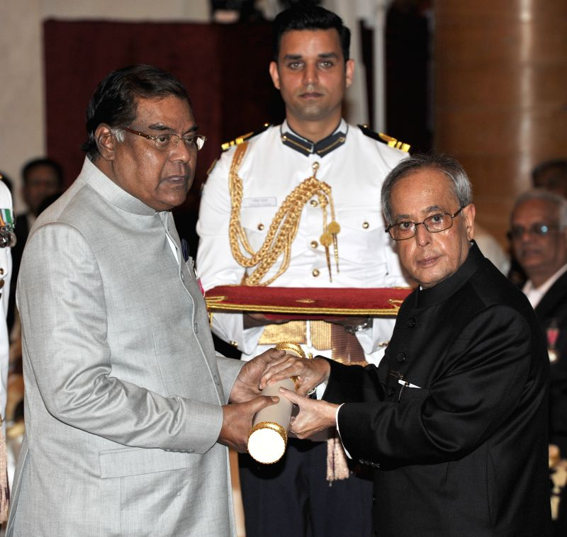 President Pranab Mukherjee presents the Padma Shri Award to Kota Srinivasa Rao, at a Civil Investiture Ceremony, at Rashtrapati Bhavan, in New Delhi on April 8, 2015. - Pranab Mukherjee
