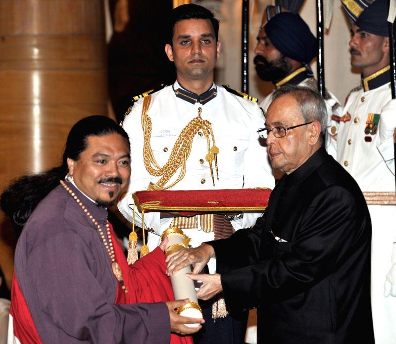 President Pranab Mukherjee presents the Padma Shri Award to Thegtse Rinpoche, at a Civil Investiture Ceremony, at Rashtrapati Bhavan, in New Delhi on April 8, 2015. - Pranab Mukherjee