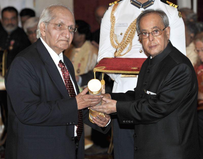 President Pranab Mukherjee presents the Padma Shri Award to Dr. Hargovind Laxmishanker Trivedi, at a Civil Investiture Ceremony, at Rashtrapati Bhavan, in New Delhi on April 8, 2015. - Pranab Mukherjee