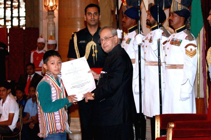 New Delhi:President Pranab Mukherjee presents the National Child Award for Exceptional Achievement 2015 to Soring Lepcha, in New Delhi on Nov 14,2015. - Pranab Mukherjee