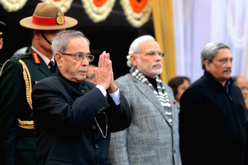 President Pranab Mukherjee, Prime Minister Narendra Modi and Union Defence Minister Manohar Parikkar during Army Day  reception at Army House in New Delhi, on Jan 15, 2015. - Narendra Modi and Pranab Mukherjee