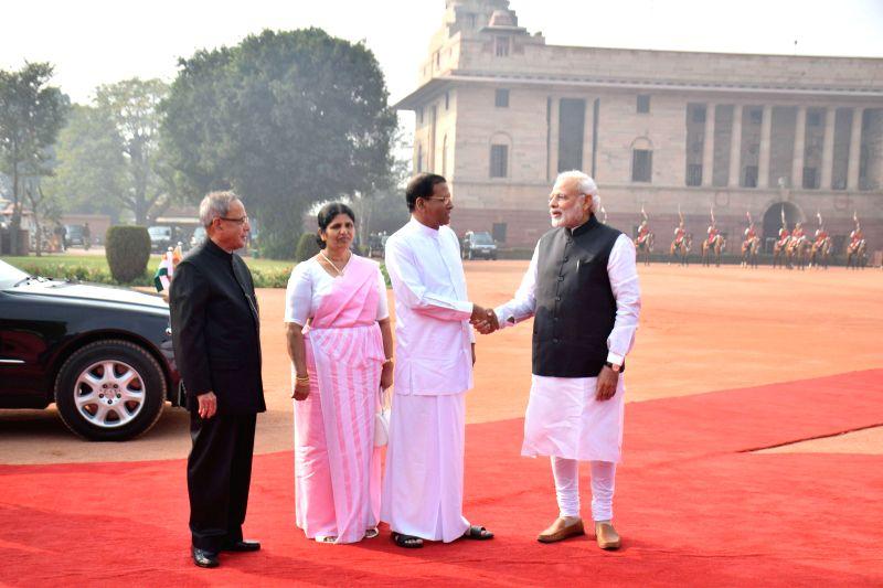 President Pranab Mukherjee, Prime Minister Narendra Modi receives Sri Lankan President Maithripala Sirisena and First Lady Jayanthi Sirisena during a ceremonial reception at Rashtrapati ... - Narendra Modi and Pranab Mukherjee
