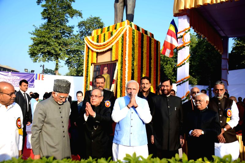 President Pranab Mukherjee,Vice President Hamid Ansari and Prime Minister Narendra Modi at Parliament house to pay tribute to Babasaheb Dr B R Ambedkar on his 59th Mahaparinirvan Diwas in . - Narendra Modi and Pranab Mukherjee