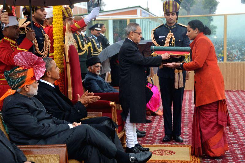 President Pranab Mukherjee, Vice-President Mohammad Hamid Ansari, Prime Minister Narendra Modi with US President Barack Obama during  Republic Day celebrations at Rajpath in New Delhi, on . - Narendra Modi and Pranab Mukherjee